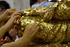 IMG_2165<br /> People place gold foil onto the Buddha for good luck