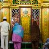 Women trying to peek inside the temple.