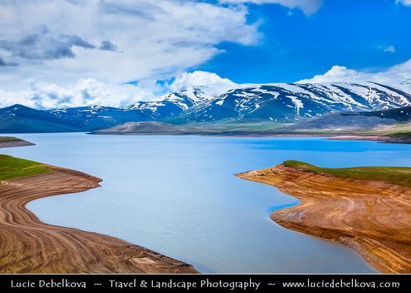 Armenia - Dramatic landscape Mountains of Vayots Dzor with snow covered mountain peaks - Spandaryan lake - reservoir - Sisian Area