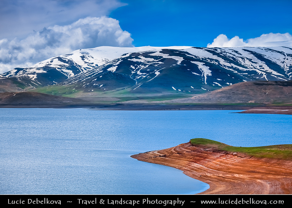 Armenia - Dramatic landscape Mountains of Vayots Dzor with snow covered mountain peaks - Spandaryan lake - reservoir - Sisian Area