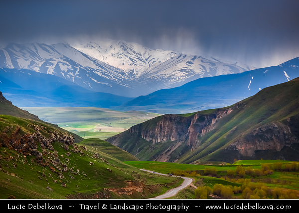 Armenia - Deep Valleys & Rugged Peaks of Vayots Dzor Mountains - Spectacular landscape with snow covered mountain peaks during dramatic stormy weather