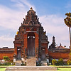 A covered gate known as candi kurung, is the entrance of the Pura Taman Ayun temple in Mengwi, Bali, Indonesia