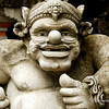 A Balinses stone sculpture  in the courtyard of a temple in Bali, Indonsesia