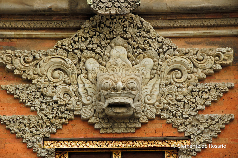 Intricate Balinese carving at the entrance of a temple in Bali, Indonesia