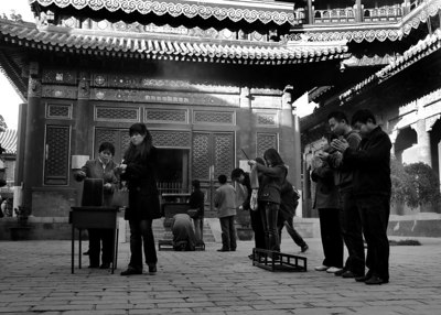 "The Yonghe Temple, also known as the ""Palace of Peace and Harmony Lama Temple"", the ""Yonghe Lamasery"", or - popularly - the ""Lama Temple"" is a temple and monastery of the Geluk School of Tibetan Buddhism located in the northeastern part of Beijing, China. It is one of the largest and most important Tibetan Buddhist monasteries in the world. The building and the artworks of the temple combine Han Chinese and Tibetan styles."