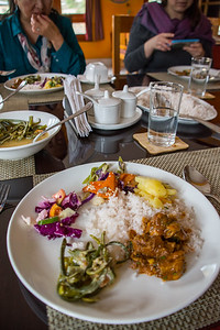 A typical Bhutanese meal: lots of veggies and rice, with just a little meat.
