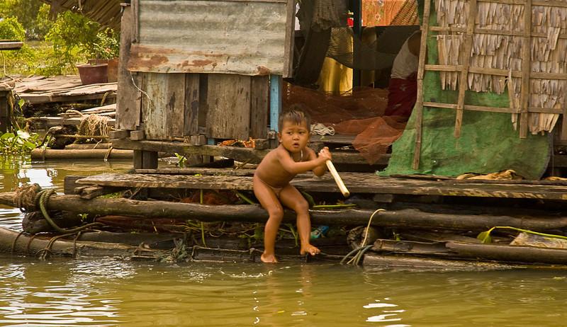 Child playing on the Tonlé Sap at Kompong Chhnang floating village