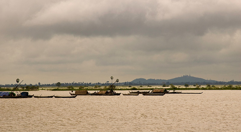 Life on the Tonlé Sap at the end of the rainy season; note the temple spires on the distant hills in the background right.