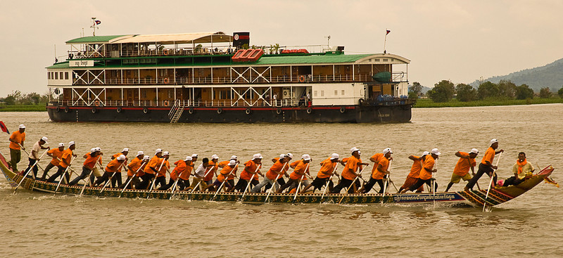 Dragon boat racing practice, Sunday morning on the Tonlé Sap at Kompong Chhnang with the Tonle Pandaw cruise ship in the background.