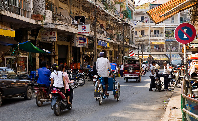 Two- and three-wheeled vehicles vastly outnumber cars on Phnom Pemh streets.