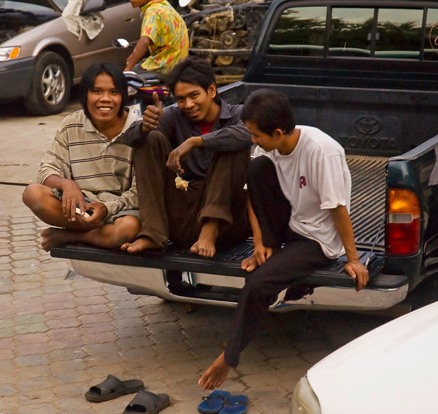 End of the day at an open-air automotive shop in the suburbs of Phnom Penh.