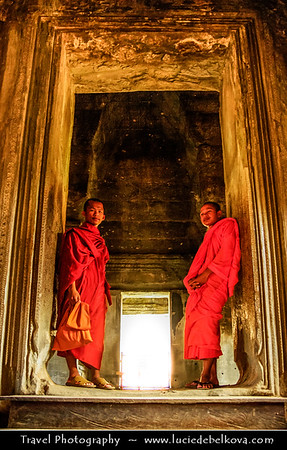 Asia - Cambodia - Prasat Angkor Wat - Largest Khmer temple complex in world - UNESCO World Heritage Site - One of the most important archaeological sites in South-East Asia stretching over some 400 km2 containing magnificent remains of the different capitals of the Khmer Empire from the 9th to the 15th century - Angkor Wat - Angkor Vat Temple - The best-preserved temple at the site - The only one to have remained a significant religious centre since its foundation - Buddhist monks in traditional orange robes wondering the ancient temple