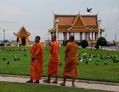 Phnom Penh, Cambodia Monks in front of a temple structure at the Phnom Penh waterfront.