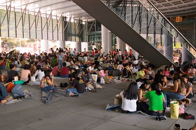 The heat was so oppressive that people came to the city to picnic in the shade of a buliding
