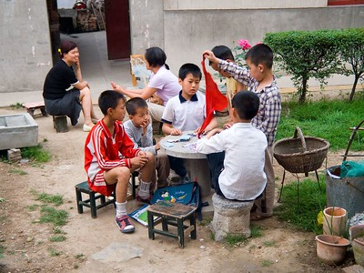 ... and then played together. Thered scarf is the symbol of high academic achievement, used throughout China
