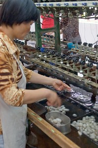 Workers find the start of the thread by hand