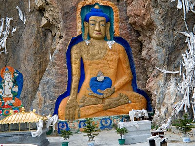 Believers throw scarves up the Buddha carved into a mountain. The higher, the better.