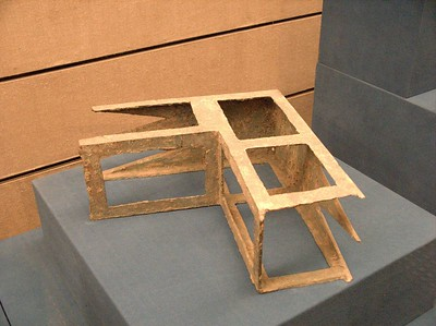 A metal form used by pre-historic Chinese to construct houses. Similar items are now available at Home Depot