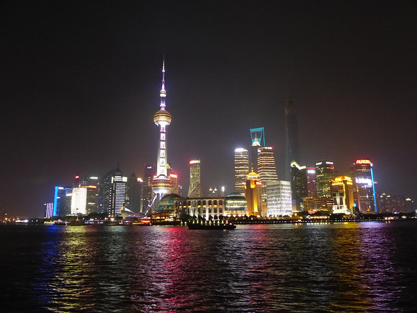 Skyline at night from The Bund.  Tall pointed building is the Pearl Tower, Shanghai, China