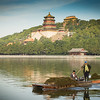 Maintenance boat on artificial lake in Summer Palace.