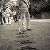 Some old men wrote auspicious characters in water on the paving stones at the Summer Palace.