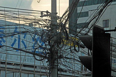 Typical wiring in a city that is growing faster than the infrastructure can keep up.