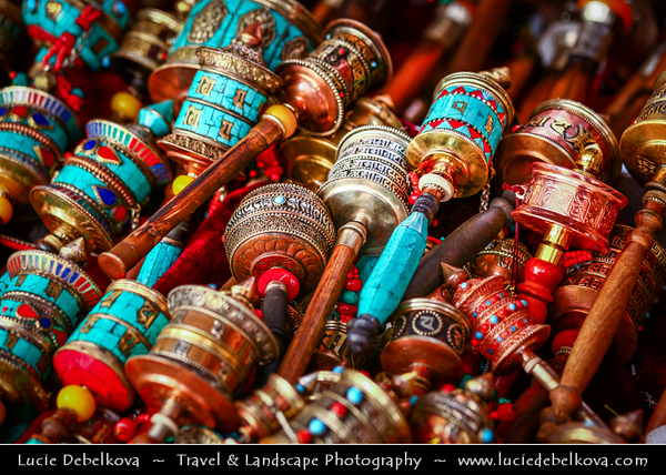 Asia - China - Tibet - Lhasa - Tibetian capital on Tibetan Plateau at altitude of 3,490 metres (11,450 ft) - Barkhor Square - Area of traditional narrow streets around Jokhang Temple, popular devotional circumabulation for pilgrims and locals - Small Traditional Tibetan Buddhist Prayer Wheel