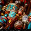 Asia - China - Tibet - Lhasa - Tibetian capital on Tibetan Plateau at altitude of 3,490 metres (11,450 ft) - Barkhor Square - Area of traditional narrow streets around Jokhang Temple, popular devotional circumabulation for pilgrims and locals - Small Traditional Tibetan Buddhist Prayer Wheel