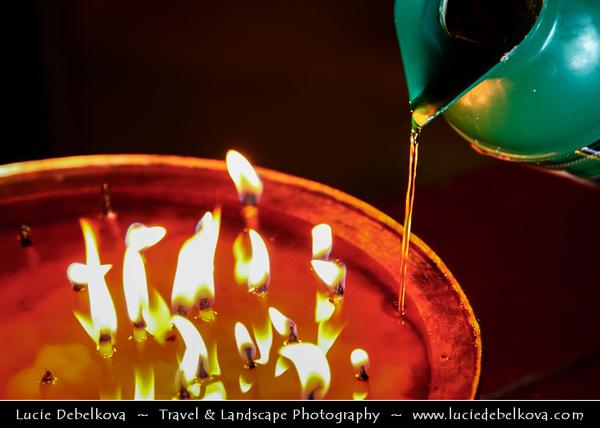 "Asia - China - Tibet - Lhasa - Tibetian capital on Tibetan Plateau at altitude of 3,490 metres (11,450 ft) - Sera Monastery - Wild Roses Monastery - One of the ""great three"" Gelug university monasteries of Tibet - Devotional candles burning yak butter oil"