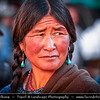 Asia - China - Tibet - Lhasa - Tibetian capital on Tibetan Plateau at altitude of 3,490 metres (11,450 ft) - Barkhor Square - Area of traditional narrow streets around Jokhang Temple, popular devotional circumabulation for pilgrims and locals - Local Tibetian Woman with Traditional Turquoise Jewelry