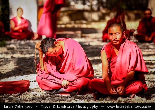 """Asia - China - Tibet - Lhasa - Tibetian capital on Tibetan Plateau at altitude of 3,490 metres (11,450 ft) - Sera Monastery - Wild Roses Monastery - One of the """"great three"""" Gelug university monasteries of Tibet - Buddhist Monks in red robes engaging in traditional monastic debate in courtyard"""