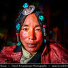 Asia - China - Tibet - Lhasa - Tibetian capital on Tibetan Plateau at altitude of 3,490 metres (11,450 ft) - Drepung Monastery - Largest of all Tibetan monasteries located on the Gambo Utse Mountain - Local Tibetian Woman with Traditional Turquoise Jewelry