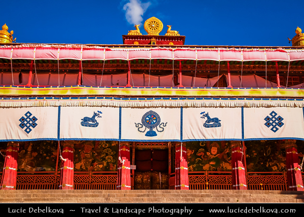 Asia - China - Tibet - Lhasa - Tibetian capital on Tibetan Plateau at altitude of 3,490 metres (11,450 ft) - Drepung Monastery - Largest of all Tibetan monasteries located on the Gambo Utse Mountain - Tibetan Buddhism Dharma Wheel of life and two deer