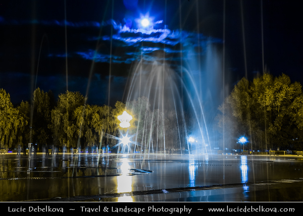 Asia - China - Tibet - Lhasa - Tibetian capital on Tibetan Plateau at altitude of 3,490 metres (11,450 ft) - Water fountains performance at the Lhasa main square opposite of the Potala Palace at Night during Full Moon