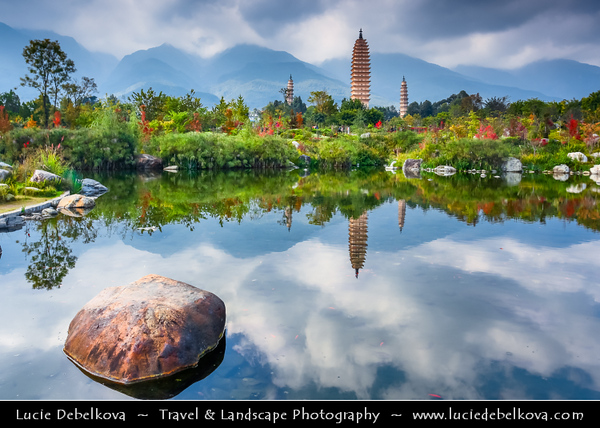 Asia - China - Southwest China - Yunnan Province - Dali - Chongsheng Temple with Three Pagodas - Unique China's Ancient Buddhist architecture - Three independent pagodas arranged on the corners of an equilateral triangle, dating from time of Kingdom of Nanzhao & Kingdom of Dali in the 9th and 10th centuries - Pagodas Reflected in the pond