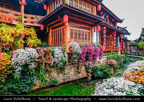 Asia - China - Southwest China - Yunnan Province -  Lijiang - 丽江- Likiang - Old Town - UNESCO Heritage Site - Ancient town with cobbled streets, rickety wooden buildings & gushing canals - Famous tourist fairyland destination in Yunnan Province