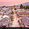 Asia - China - Southwest China - Yunnan Province - Dali - Historical town with ancient wooden houses & cobbled streets - One of Yunnan's most popular tourist destinations - Aerial View of Old Town towards Dali Ancient City Gate - Historical gate at city walls