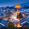 Asia - China - Southwest China - Yunnan Province - Dali - Historical town with ancient wooden houses & cobbled streets - One of Yunnan's most popular tourist destinations - Aerial View of Old Town towards Dali Ancient City Gate - Historical gate at city walls - Dusk - Twilight - Blue Hour - Night