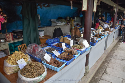 all kind of dried herbs, mushrooms, etc. for sale as medicine