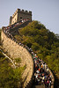 National Day on the Great Wall; the crowding was such that uniformed individuals with amplified bullhorns exhorted the group to keep moving in a density that made it likely that one ancient tourist's slip would bring the whole mass of us cascading down.