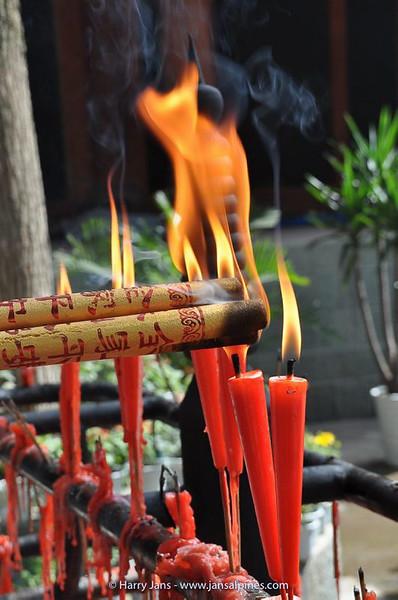 candles at small temple at Leshan