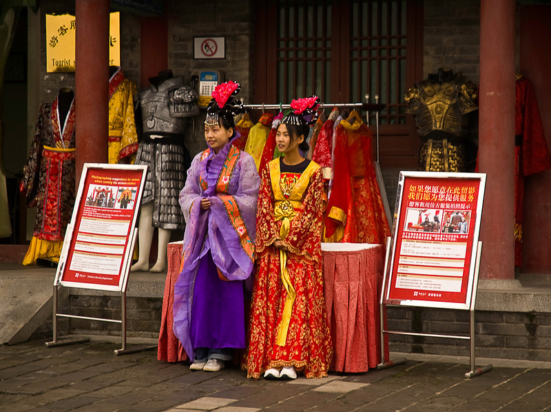 Tourists in rented costumes being photographed somewhere in the Da Ci'en Temple complex, Xian