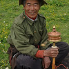 Tibetan with prayer wheel