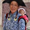 Yi woman with baby at Jiulong