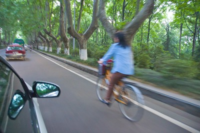 Bicyclist on the streets of Purple Mountain Park