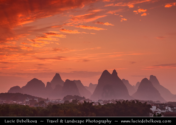 Asia - China - Southern China - Guanxi Province - Guilin - Yangshuo - Famously spectacular limestone karst along Li river surrounded by coutless verdant limestone hills, peaks & towers - Dramatic Sunrise