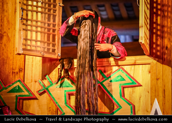 "Asia - China - Southern China - Guanxi Province - Guilin - Huangluo Yao Village - Famous ""World's Longest Hair Village"" - Dance performance Chinese Red Yao Hill Tribe ladies in traditional ethnic costumes with super long hairs reaching 1.8 meters"