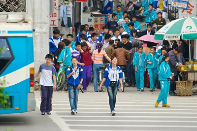 Students break for lunch. Some are in uniform while others have adopted a more Western look.