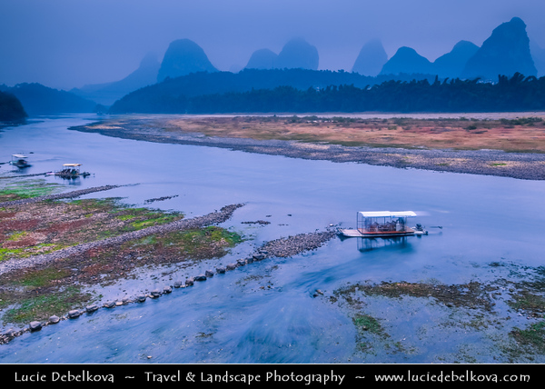 Asia - China - Southern China - Guanxi Province - Guilin - Yangshuo - Famously spectacular limestone karst along Li river surrounded by coutless verdant limestone hills, peaks & towers - Dusk - Twilight - Blue Hour - Night