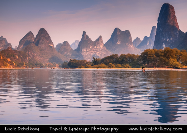 Asia - China - Southern China - Guanxi Province - Guilin - Yangshuo - Famously spectacular limestone karst along Li river surrounded by coutless verdant limestone hills, peaks & towers